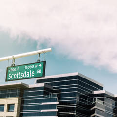 Scottsdale Road Sign with office buildings in background.  Arizona,USA.