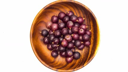 Fototapete - Put grapes into wooden plate on white background, Stop Motion
