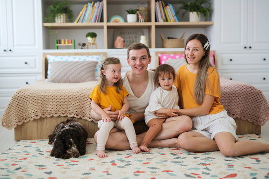 happy family and dog, child with Down syndrome