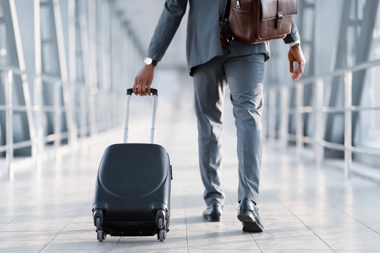 Business Trip. Businessman Carrying Suitcase, Back View