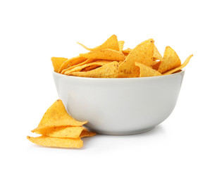 Ceramic bowl of Mexican nachos chips on white background