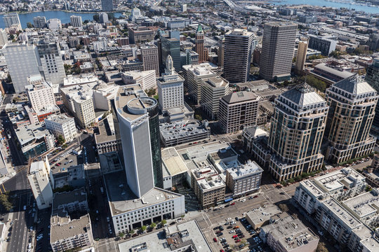 Aerial view of downtown buildings and streets in Oakland California.