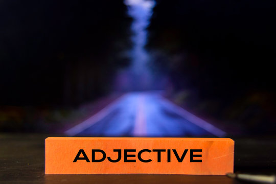 Adjective on the sticky notes with bokeh background