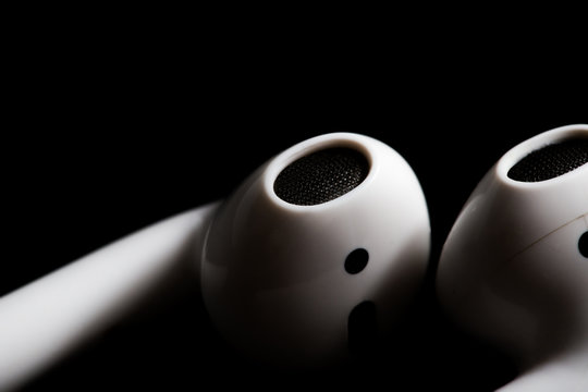 Airpod closeup on a black background