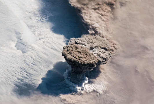 A NASA handout photo of a large volcanic ash and gas plume taken from the International Space Station of the Raikoke Volcano above the Kuril Islands