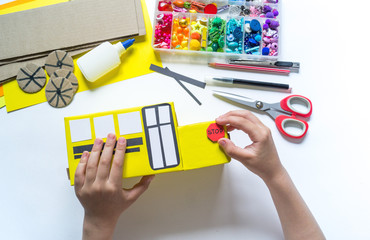 School bus made of cardboard. DIY children's pencil case for stationery paper craft.