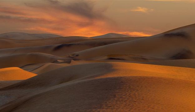Beautiful sand dunes Landscape at Sunrise in the Namib desert.