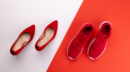 A studio shot of pair of running vs high heel shoes on color background. Flat lay.