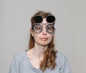 Cross eyed girl with welding glasses