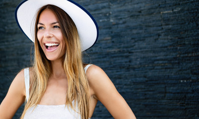 Beautiful brunette young woman wearing dress and hat, smiling outdoor Wall mural