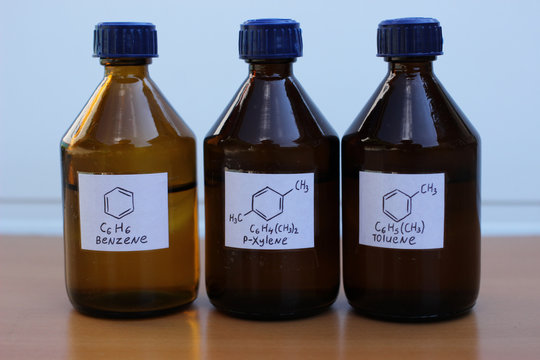 Organic solvents in dark glass bottles: benzene, p-xylene, toluene.