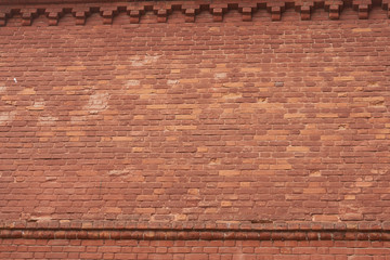 red brick wall texture grunge background with vignetted corners,