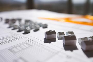 Close up of model over blueprint on desk