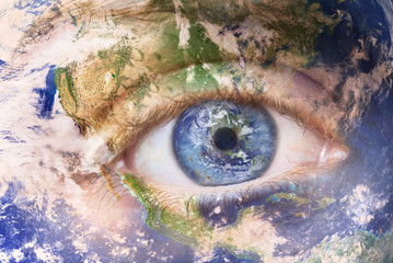 Earth awakening concept, save the planet. Close up image of woman face with earth painted. Creative composite of macro Eye with Earth as Iris. Elements of this image furnished by NASA .