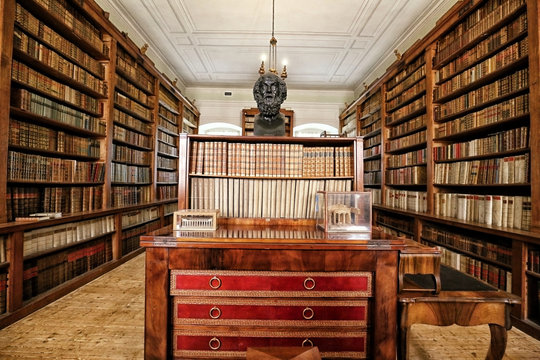 Historic library with waffle ceiling and Socrates bust