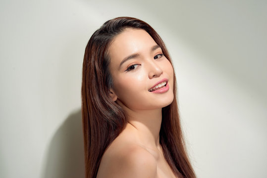 Beauty asian girl with long and shiny hair . Beautiful model woman with long hairstyle. Care and beauty