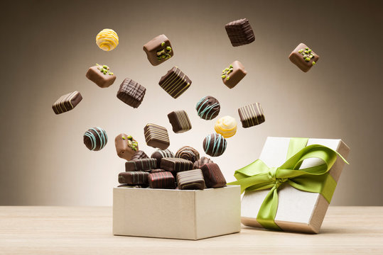 mix of chocolates jumping from gift box