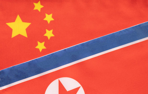 Concept of Bilateral relationship between two countries showing with two flags: China and North Korea