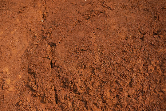 Abstract rough red soil texture