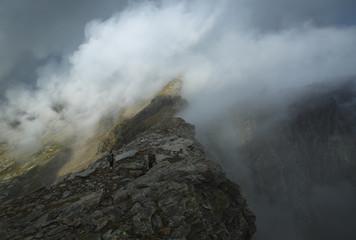 Fotomurales - Female hiker on a mountain ridge, hiking the Via Alta Verzasca in Ticino, Switzerland.