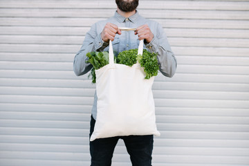 White eco cotton bag filled with grocery for mock up or your logo Wall mural