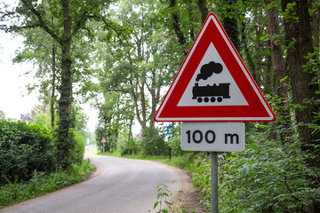 Dutch warning road sign with train meaning level crossing without barrier or gates ahead