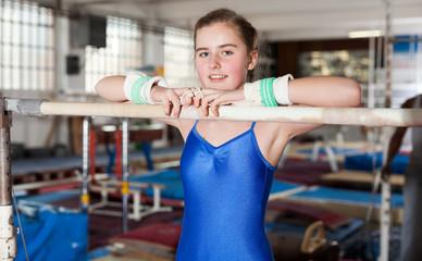 Girl training gymnastics at acrobatic hall