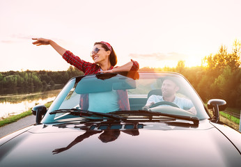Couple in love traveling by cabriolet