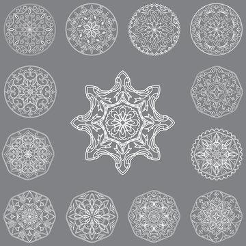 Set of decorative elements mandala on grey background.