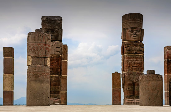 stone carved toltec empire totems pillars monuments on top of a pyramid in tula mexico