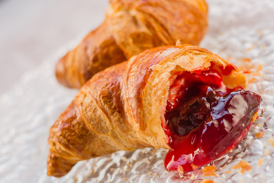 Beautiful croissant with jam on plate