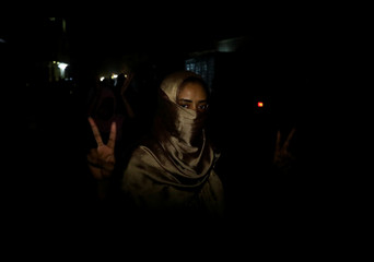 Sudanese woman makes victory sign during a demonstration in Khartoum