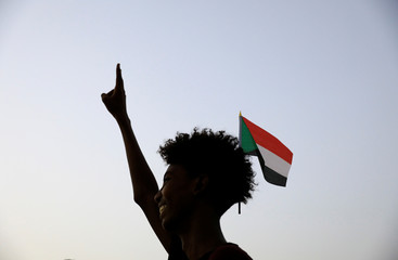 Sudanese demonstrator makes a victory sign during a demonstration in Khartoum