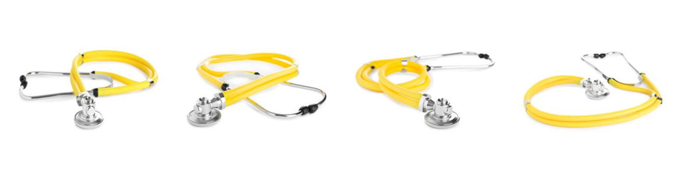 Set of yellow stethoscopes on white background. Medical device