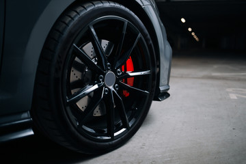 Front wheel of modern car Fototapete