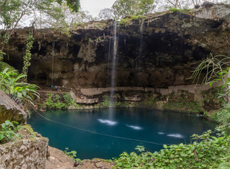 Cenote Zaci - Valladolid, Mexico: is a natural sinkhole, resulting from the collapse of limestone bedrock that exposes groundwater underneath