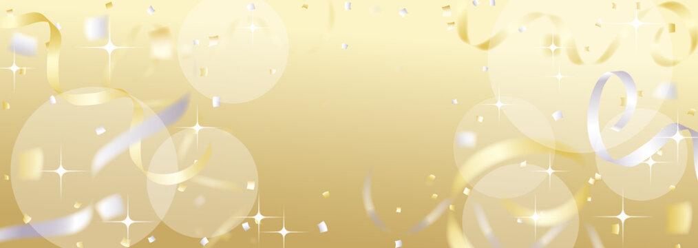 紙吹雪やテープが舞う金色の背景