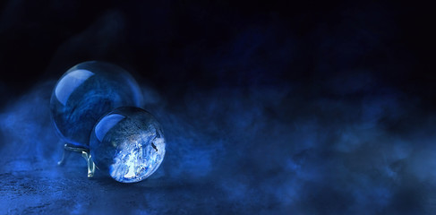 magic ball predictions. mysterious composition with glass magic ball and smoke on dark scene. Fortune teller, mind power, prediction concept. mysterious mystical background.  banner. copy spase