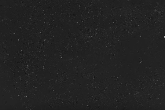 Dust and scratches design. Black abstract background. Tiny white lights. Copy space.