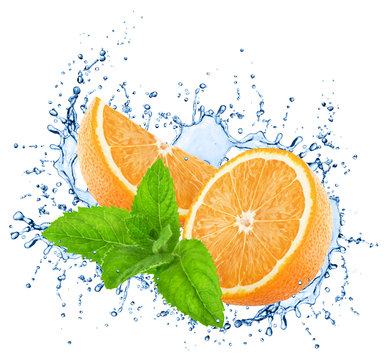 Cutted oranges with mint in water splashes isolated on white background.