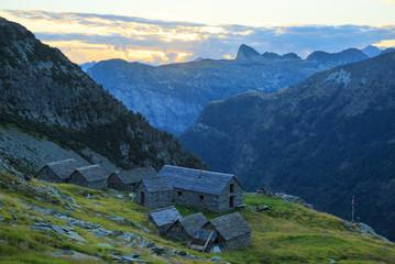 Tranquil dusk at an old mountain hut (Capanna Alpe Cornavosa) in Ticino, Switzerland.