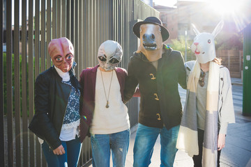 portrait of young people with funny masks