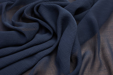 Silk fabric with viscose. Color is dark gray. Texture, background, pattern.