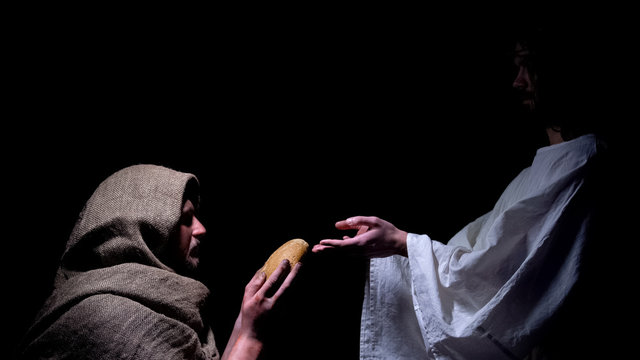 Mercy Jesus in crown of thorns giving bread for hungry homeless man, miracle