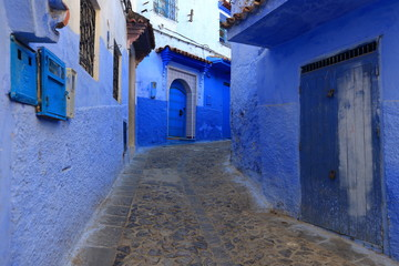 Foto op Plexiglas Marokko Blue street walls of the popular city of Morocco, Chefchaouen. Traditional moroccan architectural details.