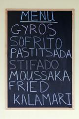 Menu on a blackboard, Greek dishes, gyros, Sofrito, Pastitsada, stifado, moussaka and fried calamari, Paleokastrista, island Corfu, Ionian Islands, Greece, Europe