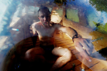 Liiv enjoys a sauna in an old yellow Audi car converted into a small sauna in Tallinn