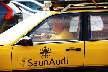 Maesalu, inventor and owner of the old yellow Audi car converted into a small sauna, drives in the parking lot in Tallinn