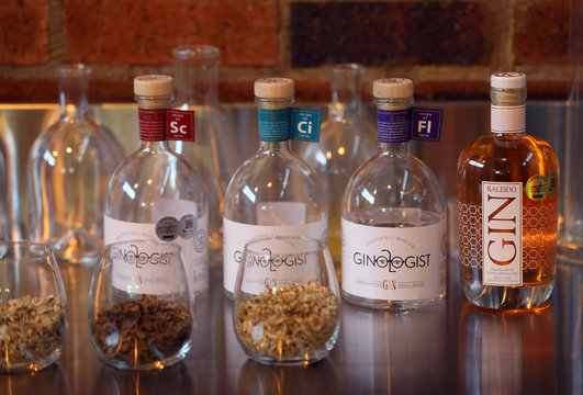 Bottles of gin and ingredients are seen at a distillery in Johannesburg