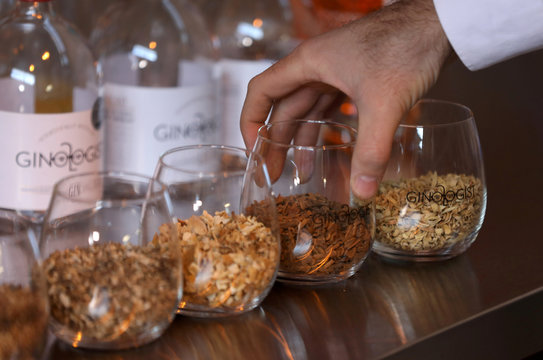 Ingredients are seen in front of bottles of gin at a distillery in Johannesburg